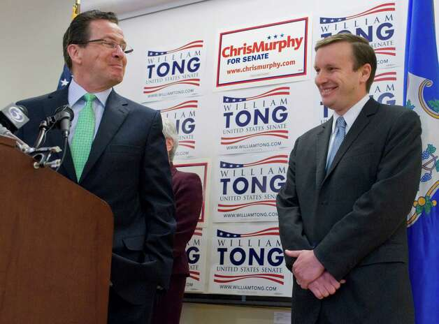 Gov. Dannel P. Malloy, left, smiles as he endorses U.S. Rep. Chris Murphy, right, for U.S. Senate during a news conference at Goodwin College in East Hartford, Conn., Tuesday, May 1, 2012. Connecticut Democrat William Tong has abandoned his bid for U.S. Senate and is throwing his support behind one-time rival Congressman Chris Murphy. (AP Photo/Jessica Hill) Photo: Jessica Hill, Associated Press / AP2012