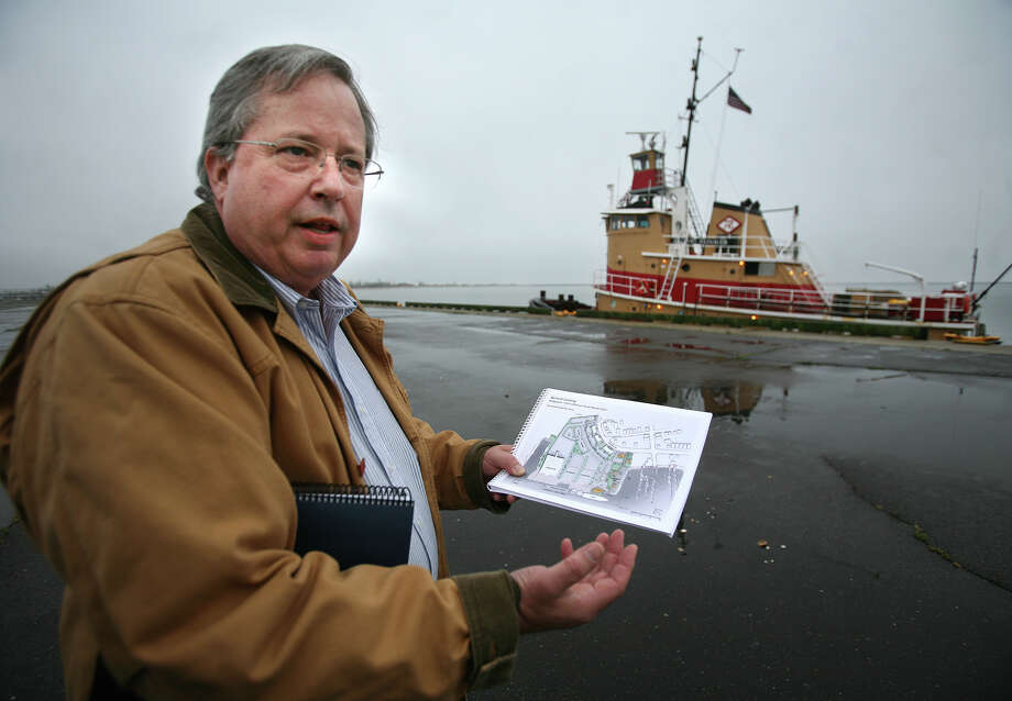 Fred Hall, vice president and general manager of The Bridgeport & Port Jefferson Steamboat Company shows design plans for a new proposed ferry terminal at the old Turbana Corp. site in Bridgeport's East End on Tuesday, May 1, 2012. Photo: Brian A. Pounds / Connecticut Post