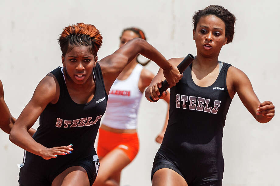 Steele's Domonique Smalls (left) takes the handoff from Alaysia Hampton in the 5A women's 400-meter relay during the Region IV Track & Field meet at Alamo Stadium on April 28, 2012.  Steele won the event with a time of 45.50 and also took the girls team title at the meet.  Photo by Marvin Pfeiffer / Prime Time Newspapers Photo: Marvin Pfeiffer / Prime Time Newspapers