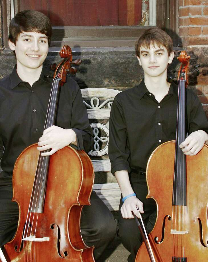 Holding cellos, left to right, are Evan Lunt, a senior at Danbury High School, and Alex Lampel, a junior at Newtown High School. The two are among musicians who will perform in Danbury Sunday, May 6, at Ives Concert Hall. Photo: Contributed Photo