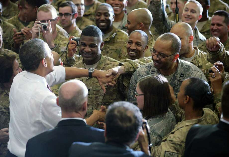 President Barack Obama greets U.S. troops at Bagram Air Field near Kabul. Nearly all U.S. troops are scheduled to leave Afghanistan by the end of 2014. Photo: Mandel Ngan / AFP / Getty Images / 2012 AFP