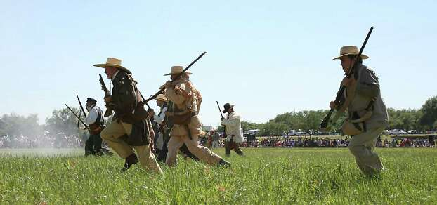 Reenactors dressed as Texian soldiers charge toward the Mexican camp during the battle reenactment commemorating the 176th anniversary of the battle of San Jacinto at the San Jacinto Battleground, Saturday, April 21, 2012, in Houston.  ( Karen Warren / Houston Chronicle ) Photo: Karen Warren, Test / © 2012  Houston Chronicle