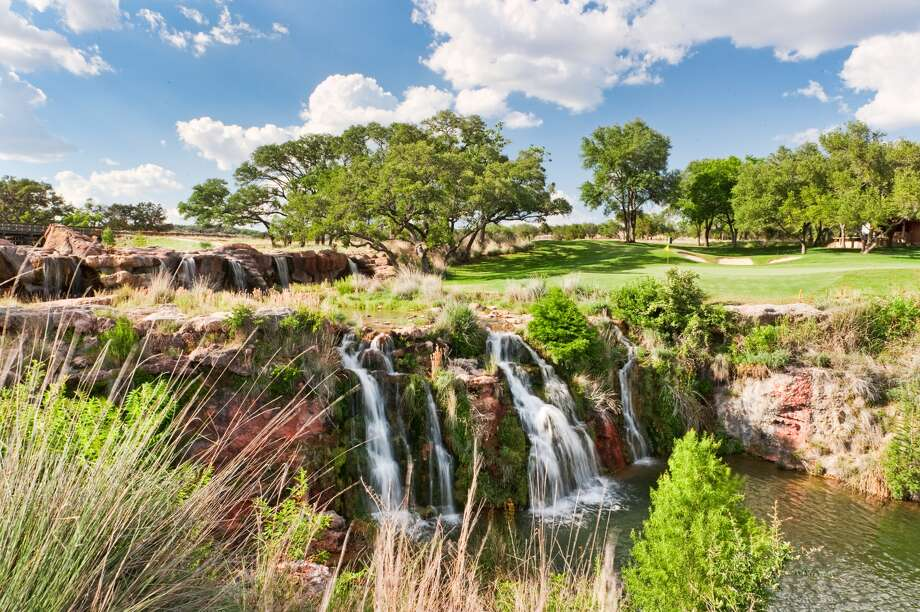 The signature hole on Boot Ranch's golf course layout in the Hill Country — the par-4 No. 10 — features 40-foot-high waterfalls near the green.  Courtesy photo / John R. Rogers