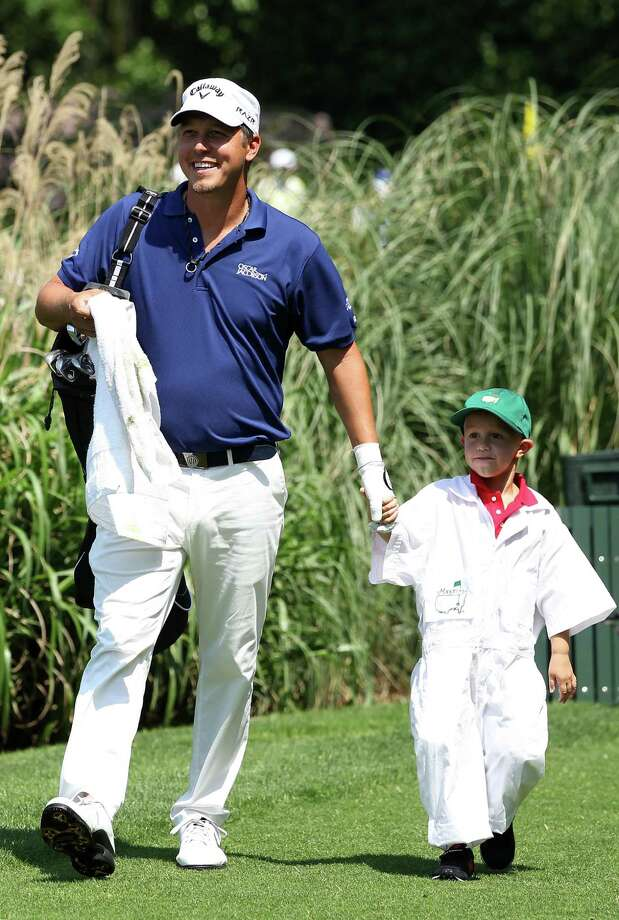 AUGUSTA, GA - APRIL 04:  Fredrik Jacobson of Sweden and a young guest during the Par 3 Contest prior to the start of the 2012 Masters Tournament at Augusta National Golf Club on April 4, 2012 in Augusta, Georgia.  (Photo by Andrew Redington/Getty Images) Photo: Andrew Redington, Getty Images / 2012 Getty Images