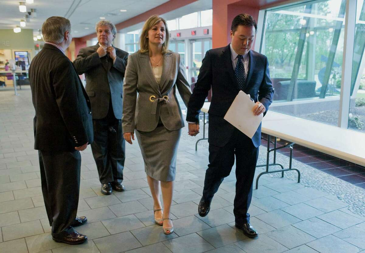 State Rep. William Tong, D-Stamford, right, holds hands with his wife Elizabeth as he walks to a news conference to announce he is dropping out of the race for U.S. Senate at Goodwin College in East Hartford, Conn., Tuesday, May 1, 2012. Tong threw his support behind one-time rival U.S. Rep. Chris Murphy. (AP Photo/Jessica Hill)
