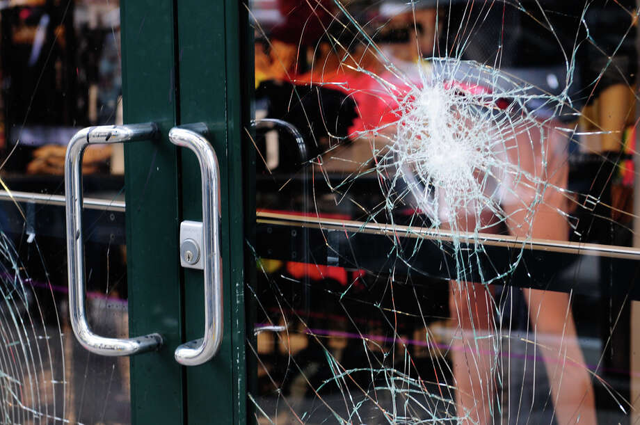 American Apparel on 6th Avenue and Pike Street  shows signs of damage from protesters. Photo: LINDSEY WASSON / SEATTLEPI.COM