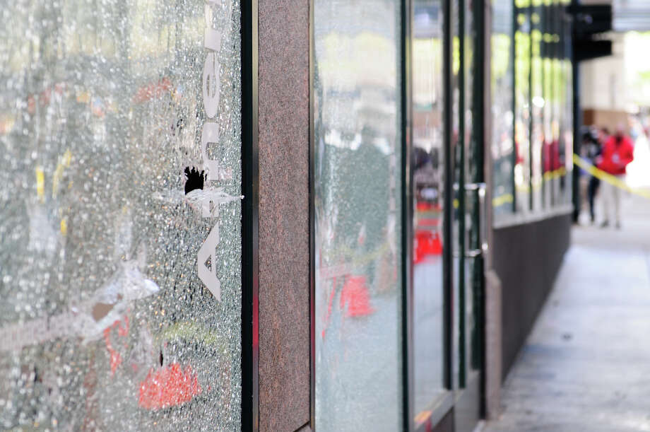 Many windows are heavily damaged on 6th Avenue and Pike Street. Photo: LINDSEY WASSON / SEATTLEPI.COM