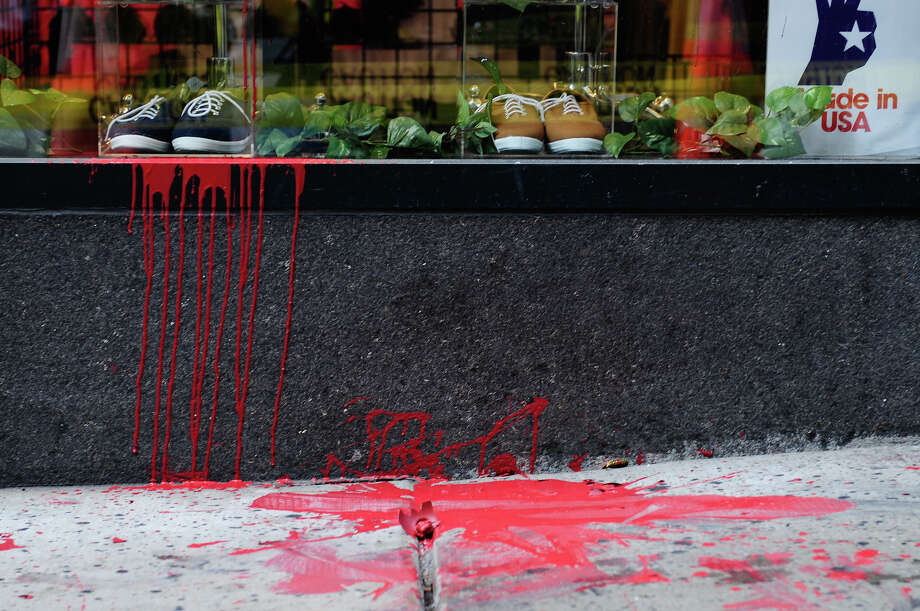 Red paint, left by protesters, falls down the side of the American Apparel storefront. Photo: LINDSEY WASSON / SEATTLEPI.COM