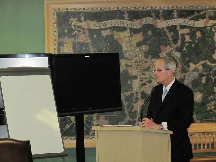 Ira Bloom, an attorney from Westport, discusses the flood issues at Jelliff Mill. Photo: Paresh Jha