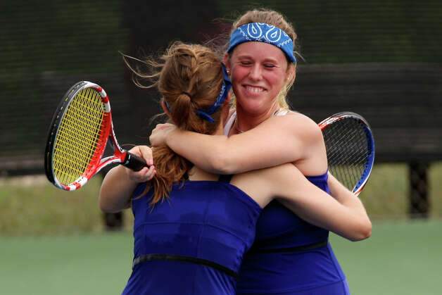 New Braunfels High School's Liza Fieldsend, right, hugs her partner, Kelli Hine, after winning the Girls 5A finals of the UIL Tennis State Tournament at World of Tennis in Lakeway, Tx, Tuesday, May 1, 2012. They beat Conroe 6-2, 6-2. Jerry Lara/San Antonio Express-News Photo: Jerry Lara, Express-News / © San Antonio Express-News