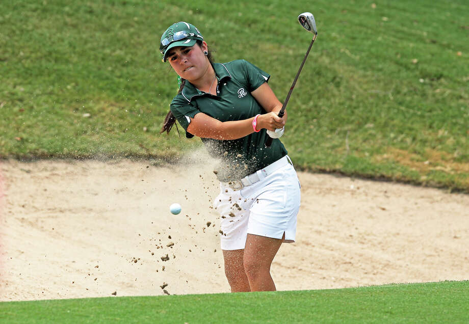Reagan's Kelly Contreras gets out of the greenside sand trap at 18 during the 5A state golf championship final round at Onion Creek Golf Club in Austin  on  May 1, 2012.  Tom Reel/ San Antonio EXpress-News Photo: TOM REEL, Express-News / San Antonio Express-News