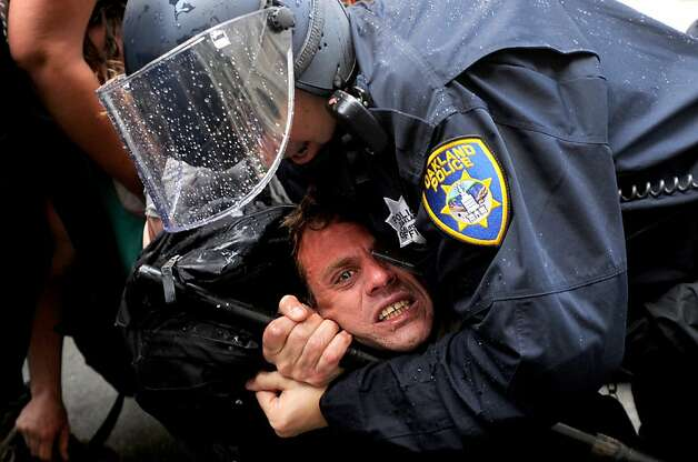 Police arrest an Occupy Oakland protester near Broadway and 14th St. on Tuesday, May 1, 2012, in Oakland, Calif. Photo: Noah Berger, Special To The Chronicle