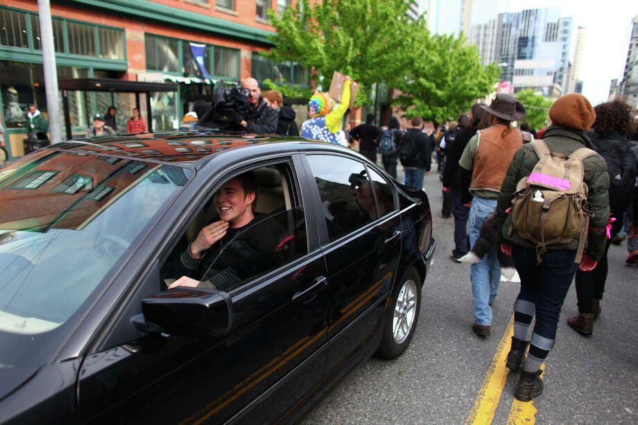 A man sits stuck in traffic. Photo: JOSHUA TRUJILLO / SEATTLEPI.COM
