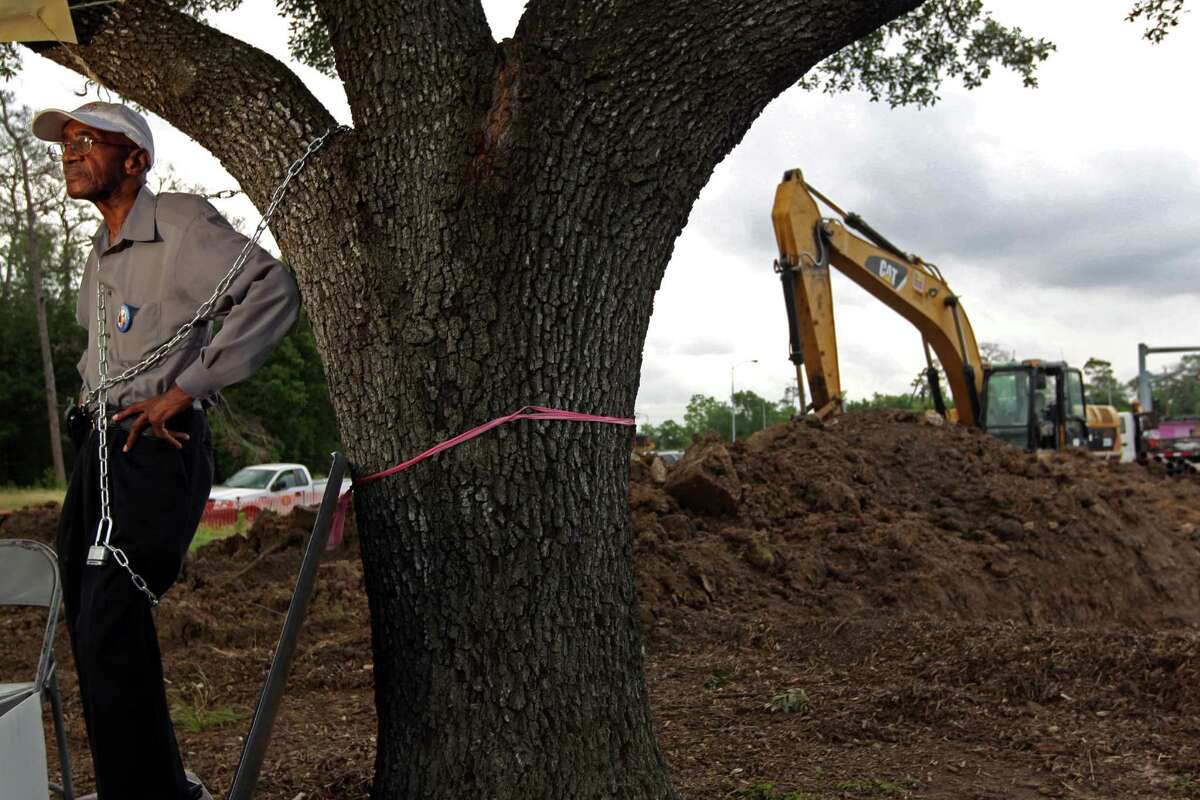 """Ovide Duncantell, director of the Black Heritage Society, chained himself to what he called """"Martin Luther King Tree of Life."""" along the esplanade of Martin Luther King Jr. Blvd. and Old Spanish Trail where the tree was being prepared to move to make way for the METRORail project Tuesday, May 1, 2012, in Houston. Duncantell said he's protesting he does not trust METRO or the City of Houston on their verbal agreement that they made to move the tree a hundred yards or so across the street into McGregor Park and to allow the Black Heritage Society to manage that spot. """"I want it in writing,"""" he said. The tree, he said, is a space-holder for a statue of Martin Luther King the society plans on having made. """"I would go to prison for this tree,"""" said Duncantell, 75. """"I can feel Trayvon Martin's spirit in this tree. I can feel Martin Luther King's spirit in this tree. It's going to be a fight."""" The move is part of a plan to relocate the 29-year-old oak that stands in the path of Metro's Southeast light rail line under construction between Palm Center and downtown. ( Johnny Hanson / Houston Chronicle )"""