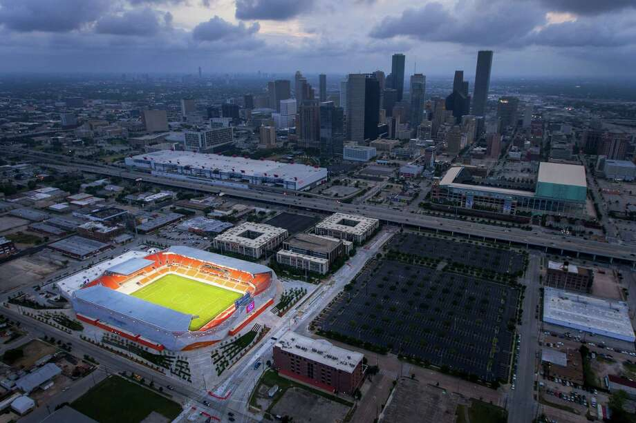 BBVA Compass Stadium, the new home of the Houston Dynamo soccer team, is seen against the downtown Houston skyline in an aerial photo on Sunday, April 29, 2012. Photo: James Nielsen, Chronicle / © 2012 Houston Chronicle