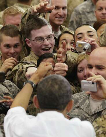 US President Barack Obama greets troops during a visit to Bagram Air Field on May 1, 2012 in Afghanistan. Obama signed a US-Afghanistan strategic partnership agreement during his unannounced visit to the country. AFP PHOTO/Mandel NGANMANDEL NGAN/AFP/GettyImages Photo: MANDEL NGAN / AFP