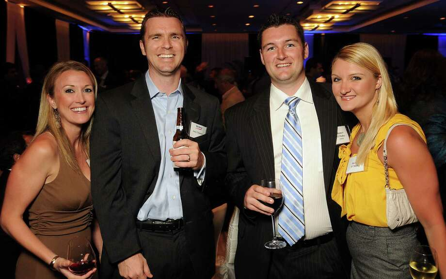 From left: Skye Cizek and Joey Clements  with Robert and Rebecca O'Malley at the Technip reception at the Hotel Derek Tuesday May 1,2012. (Dave Rossman Photo) Photo: Dave Rossman, For The Chronicle / © 2012 Dave Rossman