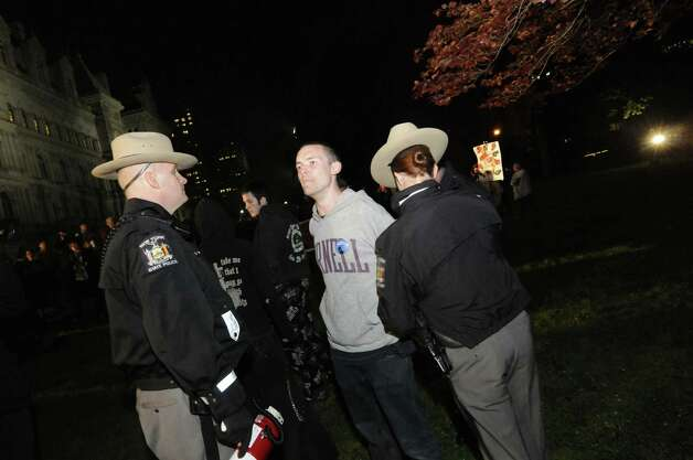 The first Albany Occupy protestor is arrested after the 11pm curfew in  Lafayette Park in Albany N.Y. Tuesday May 1, 2012. (Michael P. Farrell/Times Union) Photo: Michael P. Farrell