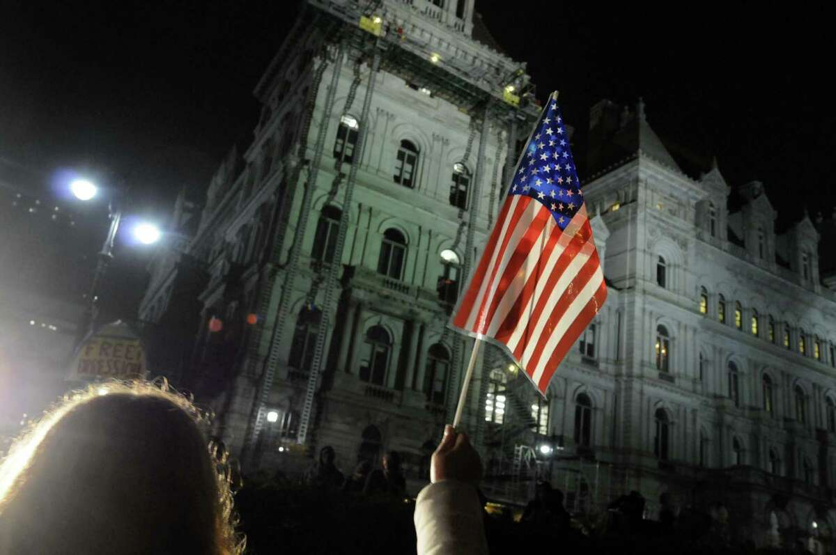 Occupy Albany protestors hold their ground following police warnings at the 11pm curfew in Lafayette Park in Albany N.Y. Tuesday May 1, 2012. (Michael P. Farrell/Times Union)