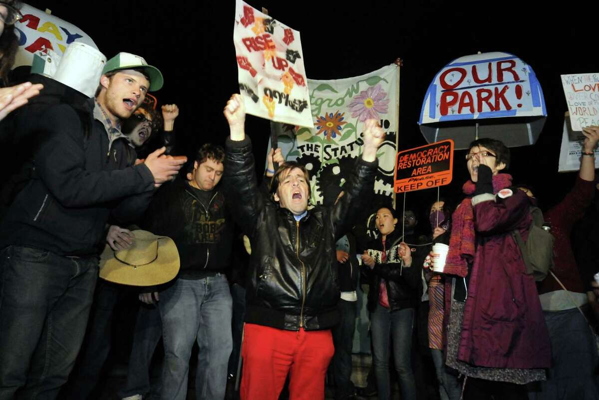 Occupy Albany protestors chant as the 11pm curfew approaches in Lafayette Park in Albany N.Y. Tuesday May 1, 2012. (Michael P. Farrell/Times Union)