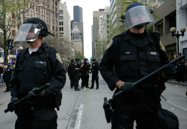 Police gather in Westlake Park during a May Day rally in downtown Seattle. Photo: SOFIA JARAMILLO / SEATTLEPI.COM