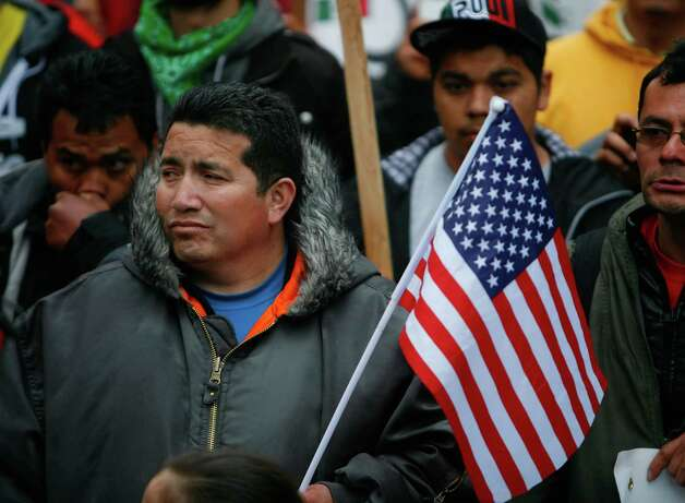 People rally for immigrant rights, a march largely eclipsed by earlier violent marches by black-clad marchers. Photo: SOFIA JARAMILLO / SEATTLEPI.COM