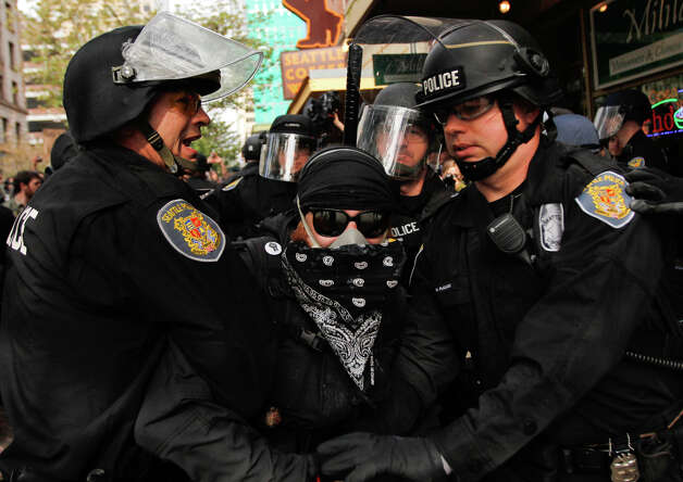 A protester gets arrested during a May Day rally on Tuesday, May 1, 2012 in downtown Seattle. Photo: JOE DYER / SEATTLEPI.COM