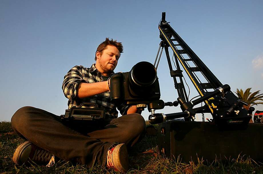 "Photographer Colin Rich sets up equipment to capture a time-lapse image of the sun setting on downtown Los Angeles, California, on December 14, 2011. ""It's really, really, difficult to shoot an original shot here,"" Rich said. ""If you want good shots, you always have to keep pushing."" (Christina House/Los Angeles Times/MCT) Photo: Christina House, McClatchy-Tribune News Service"