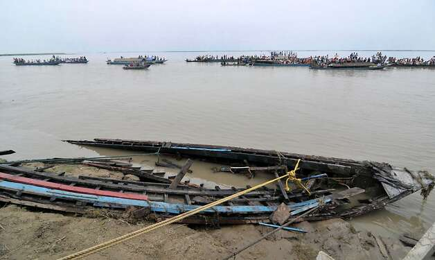 Pieces of a sunken ferry are washed up on the bank of the river Brahmaputra near Bura-Buri village in Goalpara district of Assam state, about 200 kms from Guwahati city on May 1, 2012. Indian authorities said that bodies might have been washed downstream into Bangladesh after a ferry sank in the Brahmaputra river, leaving more than 100 people dead and about 100 missing. Police said 105 corpses, including many women and children, had been recovered so far from the fast-flowing river in India's northeastern Assam state, where the ferry was split in two during a sudden storm. AFP PHOTO/ BIJU BOROBIJU BORO/AFP/GettyImages Photo: Biju Boro, AFP/Getty Images
