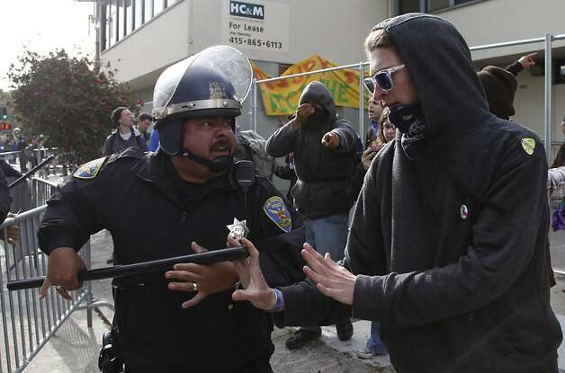 Members of Occupy SF clash with police in front of the vacant building the took over at 888 Turk St. in San Francisco Calif. Tuesday, May 1, 2012. Photo: Alex Washburn