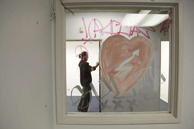 An Occupy SF supporter labels empty rooms as bedrooms inside the vacant building taken over by Occupy SF at 888 Turk St. in San Francisco Calif. on Tuesday, May 1, 2012. Photo: Alex Washburn