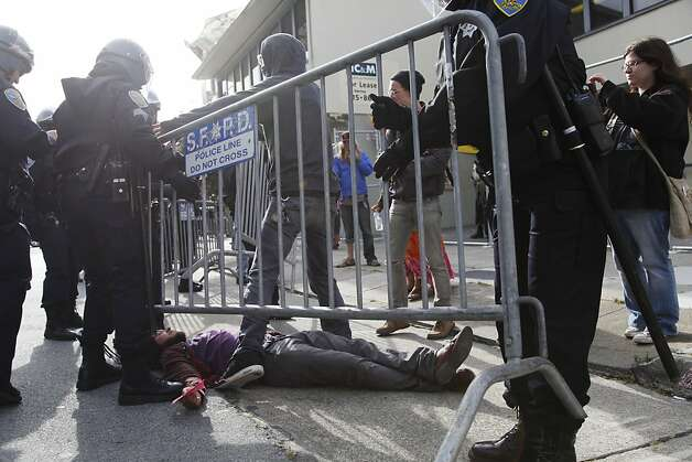 A members of Occupy SF lays down in the street to prevent police from setting up a barricade in front of the vacant building occupiers took over at 888 Turk St. in San Francisco Calif. Tuesday, May 1, 2012. Photo: Alex Washburn