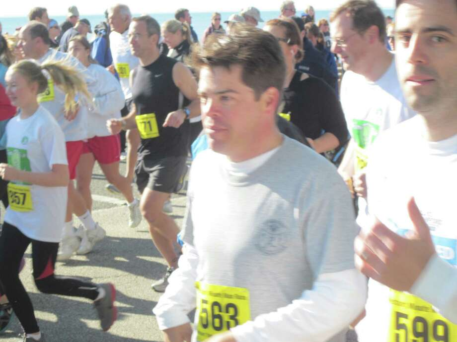Runners take off for the 34th annual Minuteman Road Race Sunday at Compo Beach. Photo: Nicole Monde / Contributed Photo