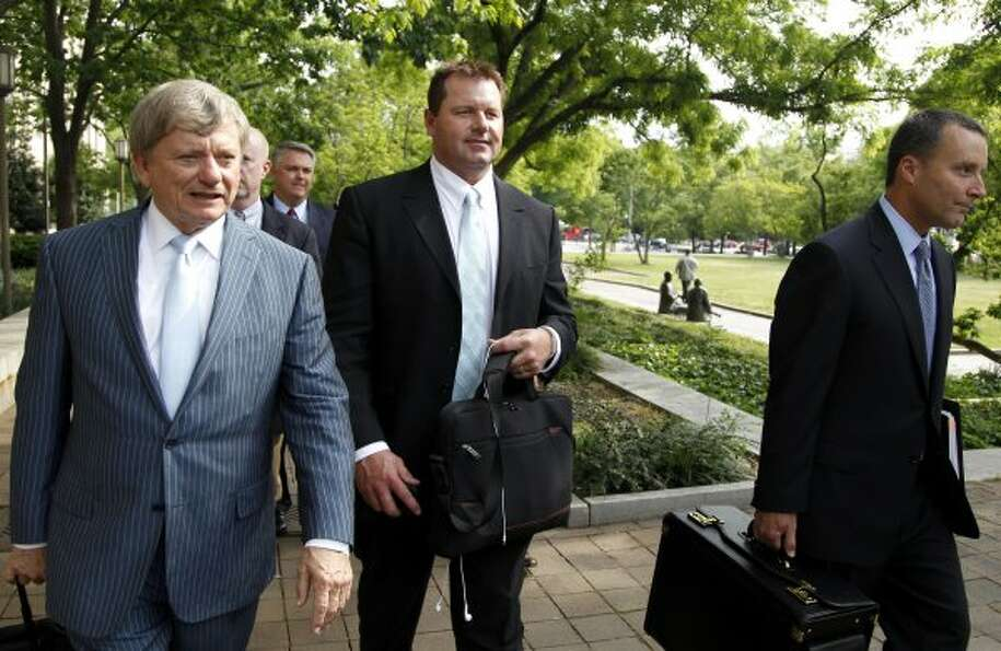 Roger Clemens, center, leaves federal court. (Haraz N. Ghanbari / Associated Press)