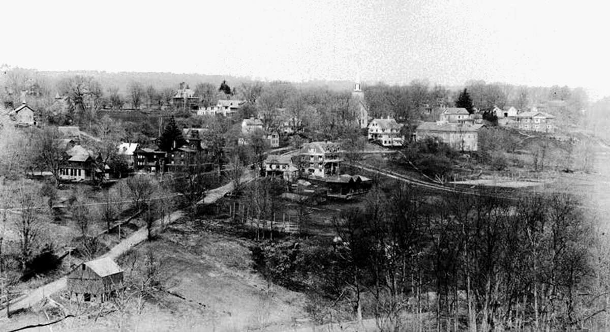 Joseph West was a prolific photographer who left a comprehensive photo documentation of Washington from 1890 to 1920. Here, this view depicts the Washington Green in 1908 as seen from Judea Cemetery Road, showing Gunnery School buildings and the First Congregational Church.