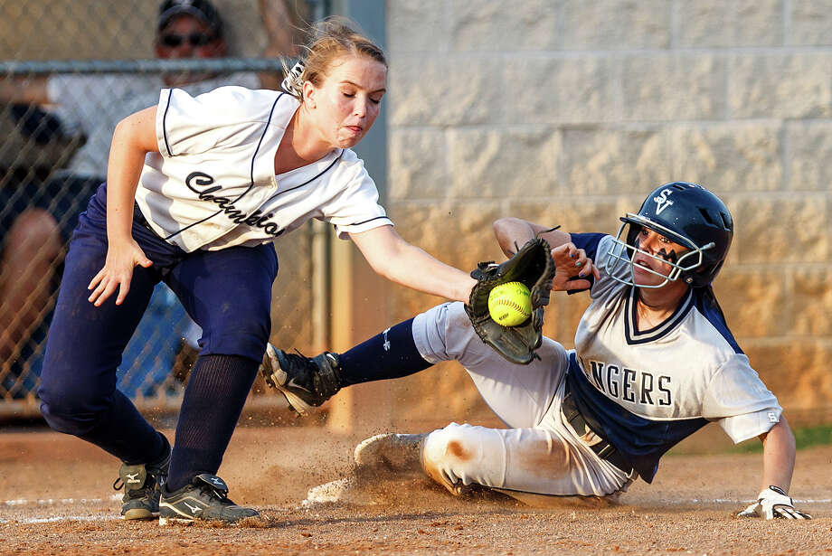 Smithson Valley's Megan Hill beats the throw to Boerne Champion third baseman Alexandra Alonso as she slides into third during the second inning of their 4A bidistrict game at the NEISD complex on April 27, 2012.  Smithson Valley advanced to the next round with a 16-2 victory in five innings over the Lady Chargers.  Photo by Marvin Pfeiffer / Prime Time Newspapers Photo: MARVIN PFEIFFER, Marvin Pfeiffer / Prime Time Newspapers / Prime Time Newspapers 2012