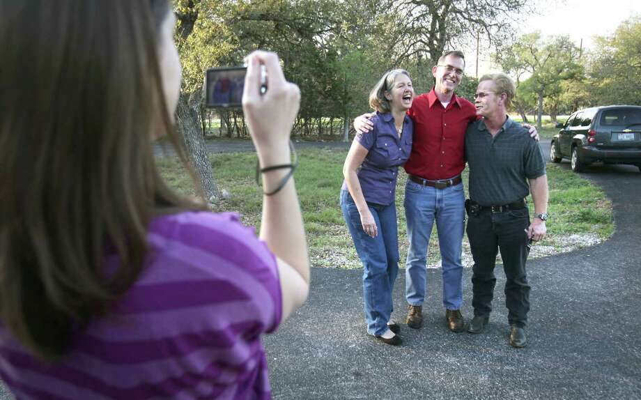 Betsy Kissinger, left, poses for a photo with her two brothers, Mike Jacoby, center and Larry Eyler. The three, from the same parents, were separated by adoption.  After 50 years, the three were reunited in Kissinger's home. Monday, March 12, 2012.  Bob Owen Photo: Bob Owen, San Antonio Express-News / © 2012 San Antonio Express-News