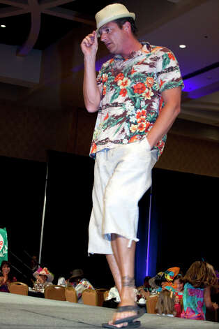 OTS/TRENDS/HEIDBRINK  Bill Taylor works the runway at the Woman's Club of San Antonio's hat contest and fashion show, a Fiesta event, at the Marriott Rivercenter Hotel. Photo by Jamie Karutz. Photo: Jamie Karutz / Special to the Express-News