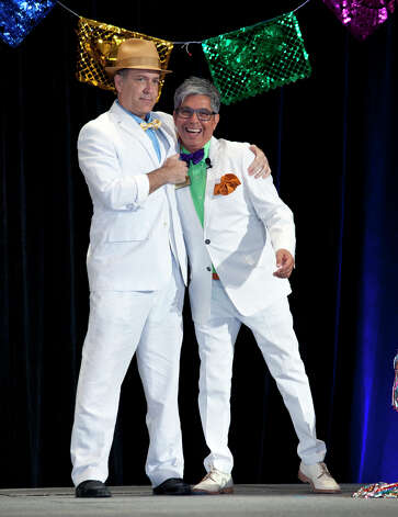OTS/TRENDS/HEIDBRINK   Model Randy Beamer and Emcee Michael Quintanilla have fun on the runway at the Woman's Club of San Antonio's hat contest and fashion show, a Fiesta event, at the Marriott Rivercenter Hotel. Photo by Jamie Karutz. Photo: Jamie Karutz / Special to the Express-News
