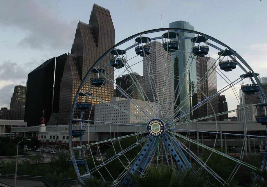 Go to the Downtown Aquarium and ride the Ferris wheel. Aquarium admission: $6.25 - $9.25. Ferris wheel: $3.99.  Photo: Carlos  Antonio Rios / Houston Chronicle
