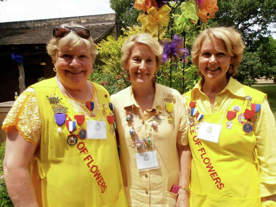 Battle of Flower Parade Picnic co-chairs Sissy Tietz, from left, Molly Webster and Gladys Montgomery take a break on the Alamo grounds before the parade begins. Photo: Nancy Cook-Monroe, For The Express-News