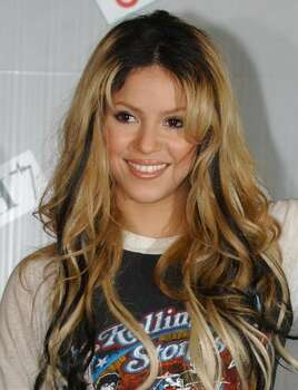 ** FILE ** Colombian pop star Shakira poses for photographers prior to a news conference in San Remo, Italy, in this March 7, 2002 file photo.  Shakira said she would not have supported the teen clothing line Delia's had she known it was caught up in accusations of unfair labor practices. Shakira, who models clothing for the company in its spring catalog and on posters, said she did not know Delia's made clothes in a Brooklyn factory caught in a wage dispute until it was reported in the Tuesday, April 30, 2002 edition of the Daily News. Photo: ANDREW MEDICHINI, AP / AP
