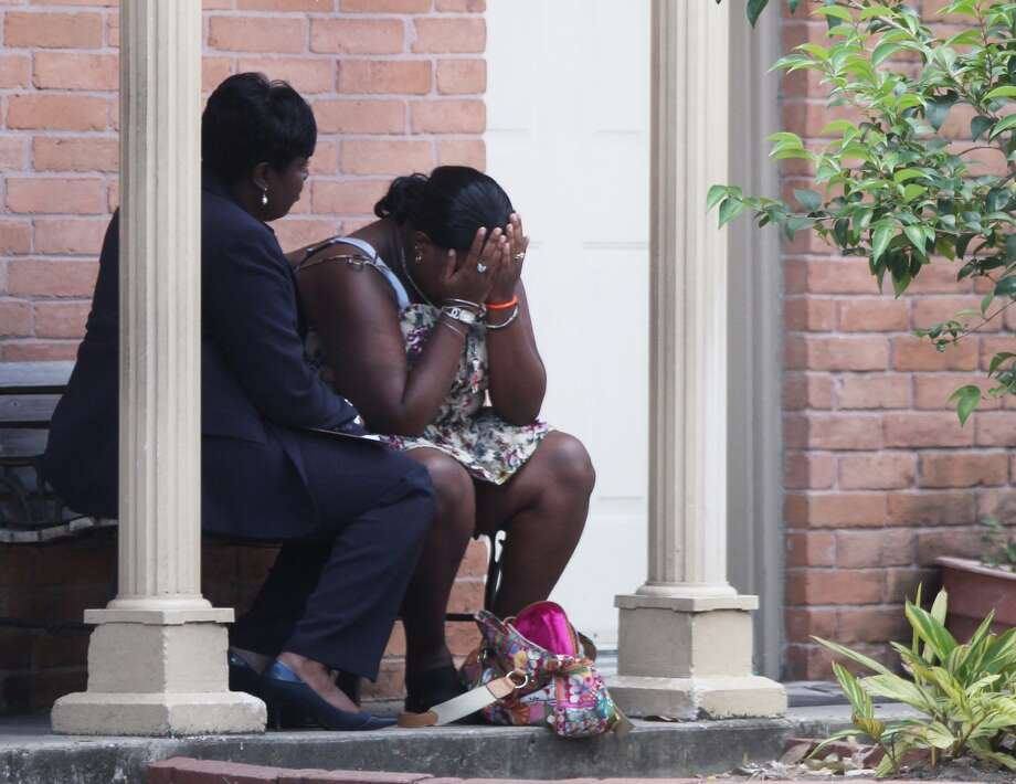 A woman reacts outside of the complex at a police investigation of the discovery of a dead infant in Houston. (Johnny Hanson/Chronicle)