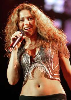 "** FILE ** Colombian singer Shakira performs during the German opening concert of her "" Oral Fixation Tour"" in Hamburg, Germany, in this Jan 25, 2007, file photo. Shakira may get high grades in singing and swiveling her hips, but what about ancient Western history?  For the past month, the Colombian pop star has attended a class at the University of California, Los Angeles, called ""Introduction to Western Civilization: Ancient Civilizations from Prehistory to Circa A.D. 843."" Photo: Fabian Bimmer, AP / AP"