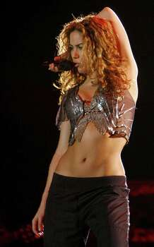 archiveplease Mumbai, INDIA: Colombian singer Shakira performs during a concert in Mumbai, 25 March 2007. The perfoemance in India's financial and entertainment capital is the Grammy award winning singer's first appearance in India.    AFP PHOTO/Sajjad HUSSAIN Photo: SAJJAD HUSSAIN, AFP/Getty Images / 2007 AFP