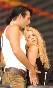 Shakira performs on stage during the 95.8 Capital Radio Party in the Park, in Hyde Park, London Sunday July 7, 2002, in aid of The Prince's Trust. (AP Photo/PA,  Yui Mok) ** UNITED KINGDOM OUT - NO SALES - MAGAZINES OUT ** Photo: YUI MOK, AP / PA