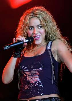 "** FILE ** In this May 17, 2008 file photo, Colombian pop star Shakira performs during ""The Concert For The Children"" in Buenos Aires. Photo: Emiliano Lasalvia, AP / AP"