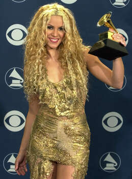 Shakira poses with the Grammy she won for best latin pop performance at the 43rd annual Grammy Awards Wednesday, Feb. 21, 2001, at the Staples Center in Los Angeles. Photo: MARK J. TERRILL, AP / AP