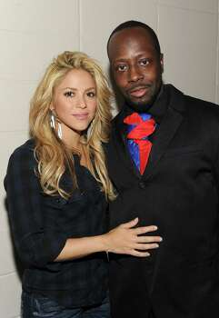 "In this image released by Hope for Haiti Now, Shakira, left, and Wyclef Jean pose backstage at ""Hope for Haiti Now: A Global Benefit for Earthquake Relief"", on Friday, Jan. 22, 2010, in New York. Photo: AP"