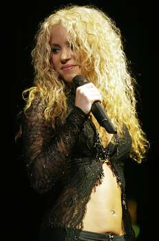 Shakira performs Tuesday, Nov. 12, 2002, at the Arrowhead Pond in Anaheim, Calif. Photo: DAMIAN DOVARGANES, AP / AP